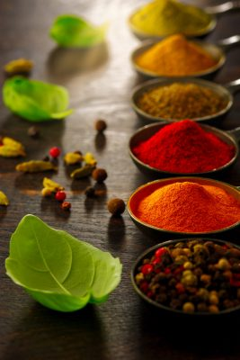 Wooden table of colorful spices curry healthy recipe clean cooking